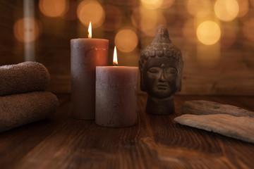 Beauty spa treatment with head of buddha statue