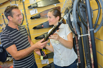 Man and woman looking at scuba equipment in store