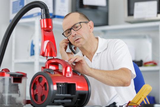 male repairing vacuum cleaner