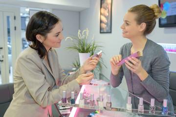 beautician advises client