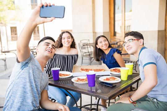 Teenagers taking selfie at restaurant