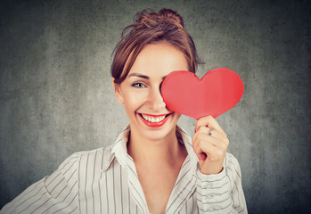 Beautiful girl holding heart shape