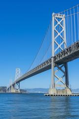 Famous Oakland Bay Suspension Bridge in San Francisco, California, USA.