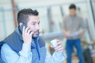 worker having a conversation on the phone during breaktime