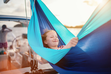 Cute girl on board of sailing yacht