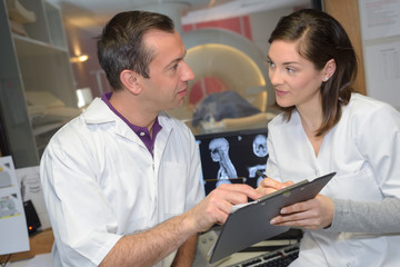female doctor discussing x-ray with doctor at the hospital