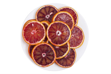 Red sicilian orange slices on the white plate