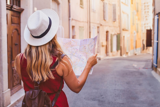 travel to Europe, tourist looking at map on the street, summer holidays sightseeing tourism