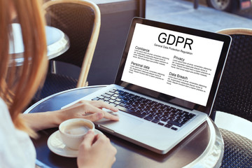 GDPR concept, woman reading about General Data Protection Regulation, private information