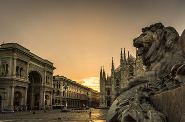 milano piazza duomo cathedral galleria and lionmonument at sunrise cloudy sky