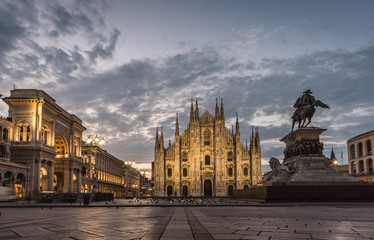 milano piazza duomo cathedral galleria and monument at sunrise cloudy sky