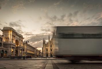 fast truck run in piazza duomo at sunrise