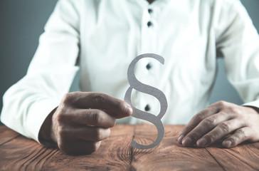 Businessman holding paper Paragraph symbol.