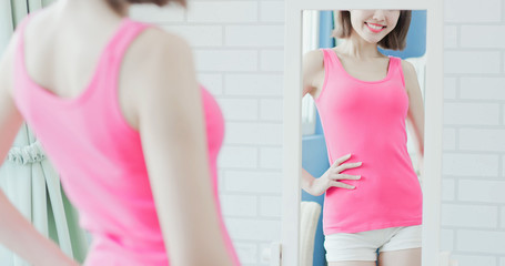 woman show her slim waist