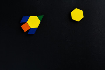 The space ship flies into space to another new planet. Summer happy atmosphere. A child plays with colored blocks constructs a model on a black background.