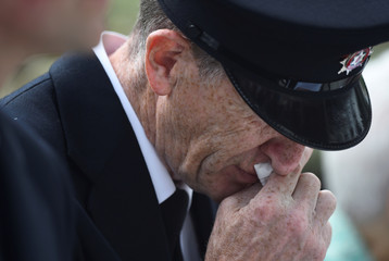 First responder fire fighter Paddy Quinn reacts as friends, relatives and victims commemorate the 20th anniversary of the IRA Omagh bombing at a ceremony in the Memorial Garden in Omagh