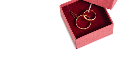 Wedding rings in a box on a white background isolation