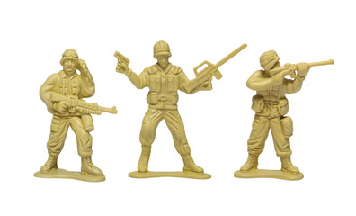 plastic toy soldiers with guns on white background