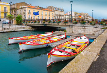 Boats moored on canal of Sete, France