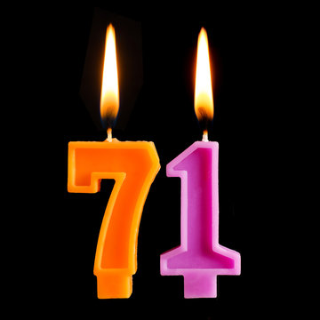 Birthday burning candles in the form of 71 seventy one for cake isolated on black background.