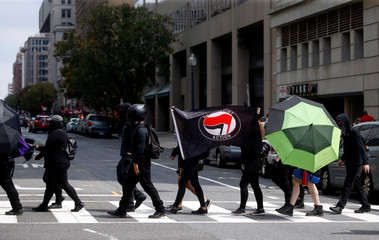 "Opponents of a white nationalist-led rally marking the anniversary of 2017 Charlottesville ""Unite the Right"" protests gather in Washington"