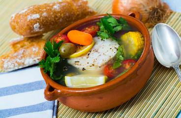 Fisherman's hoosh boiled with alaska pollock, carrots, corn and lemon
