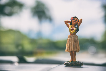 Canvas Prints American Famous Place Hawaii road trip - car hula dancer doll dancing on the dashboard in front of the ocean. Tourism and travel freedom concept.