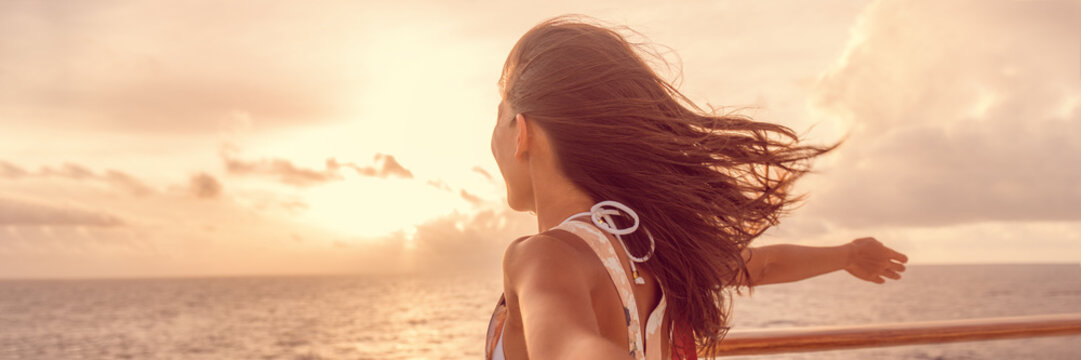 Cruise ship vacation luxury travel tourist woman enjoying freedom. Holiday tourist with open arms in front of boat feeling carefree in the tropical wind . Banner panorama.
