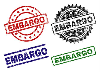 EMBARGO seal prints with corroded surface. Black, green,red,blue vector rubber prints of EMBARGO title with corroded style. Rubber seals with circle, rectangle, rosette shapes. Wall mural