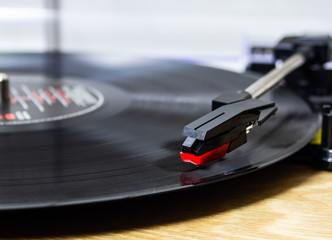 playing a vinyl record on a record player