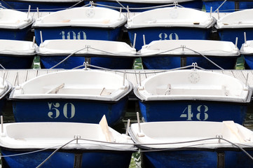 Many blue and white dingy boats background