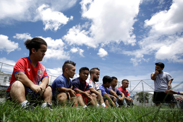People with dwarfism speak after playing soccer in a park in San Jose