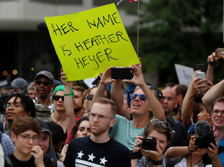 A counter-protester holds a sign near a white nationalist-led rally in Washington
