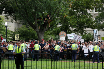 Counter-protesters are watched by police near a white nationalist-led rally in Washington