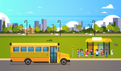 Group pupils children waiting yellow school bus station transport concept on cityscape background flat horizontal vector illustration