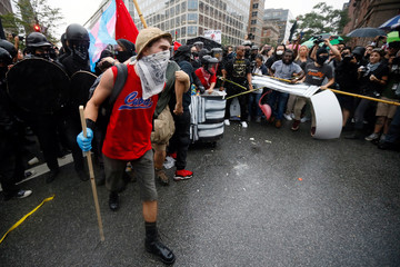 Anarchists and antifa, counter-protesters march near a white nationalist-led rallyin Washington