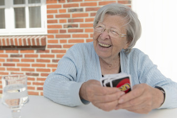 Senior Woman Playing Cards 3