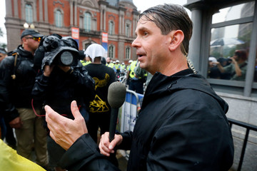 Jenkins, a Fox news channel reporter talks into a camera near a white nationalist-led rally in Washington