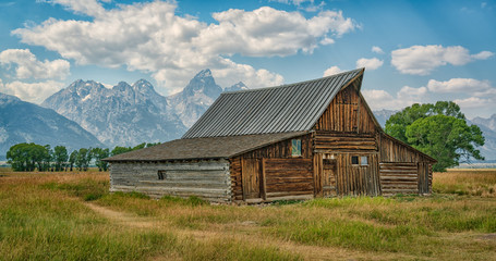 old barn with the Tetons in the background