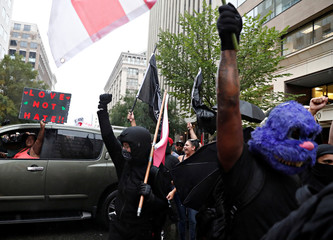 """Opponents of a white nationalist-led rally marking the one-year anniversary of the 2017 Charlottesville """"Unite the Right"""" protests, gather in downtown Washington"""