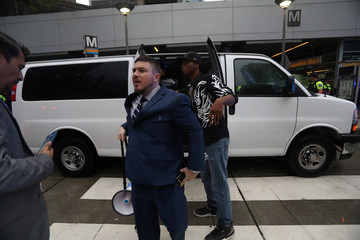 White nationalist leader Jason Kessler rides a subway to leave the area after a rally in Washington