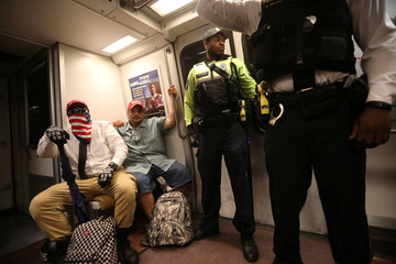 Supporters of white nationalist leader Jason Kessler ride a subway to leave the area after a rally in Washington