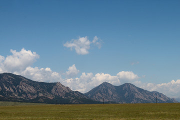 Mountains in the background with blue skies of plains