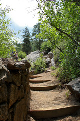 Dirt path through trees and rock for hiking in Colorado