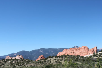 Red rocks of Garden of the Gods in Colorado Springs with mountains on horizon