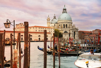 Beautiful sunset view of Grand Canal and Basilica di Santa Maria della Salute in Venice, Italy