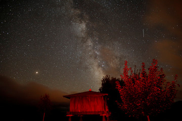 A meteor streaks past stars and the Milky Way in the night sky during the Perseids meteor shower in Berducedo
