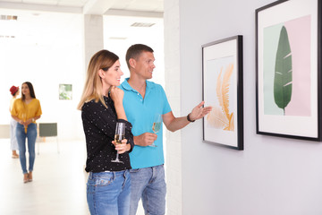 Couple at exhibition in art gallery