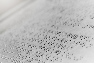 Close up braille text writing on iron plate background