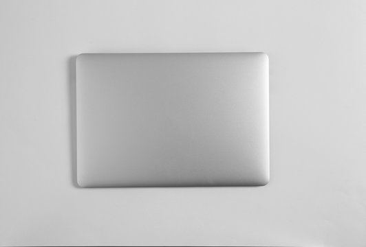 Modern laptop on light background, top view